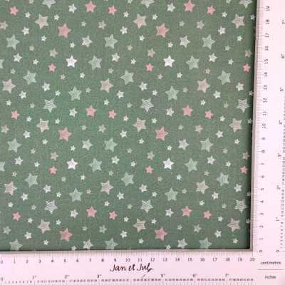 Tela verde de algodón con estrellas en verde, blanco y rojo.
