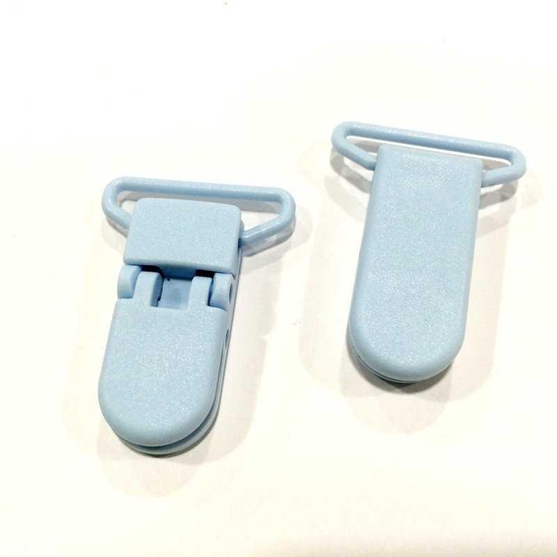Pinza de plástico azul celeste