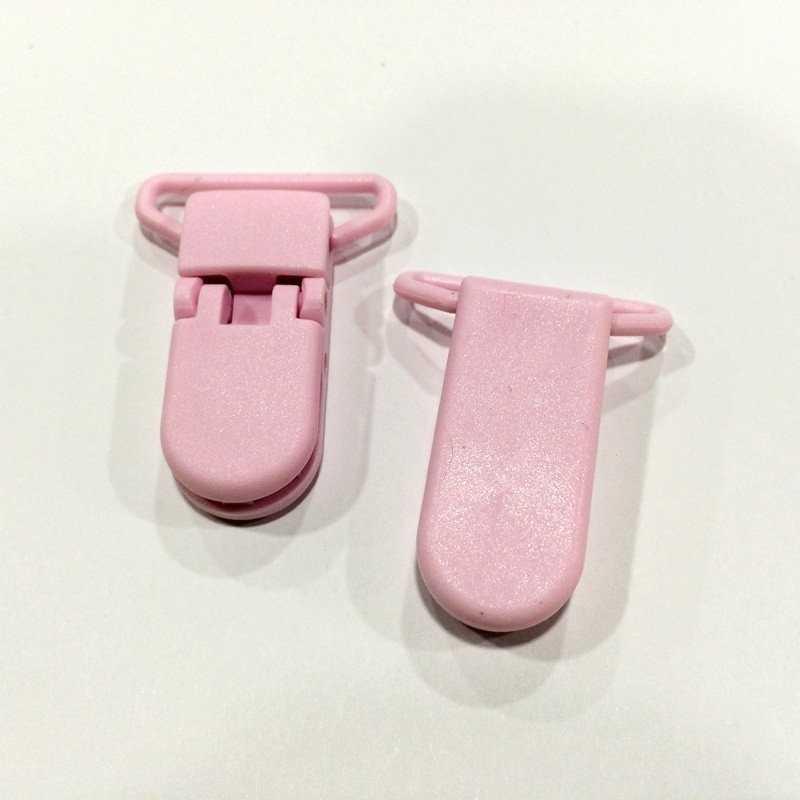 Pinza de plástico rosa pálido