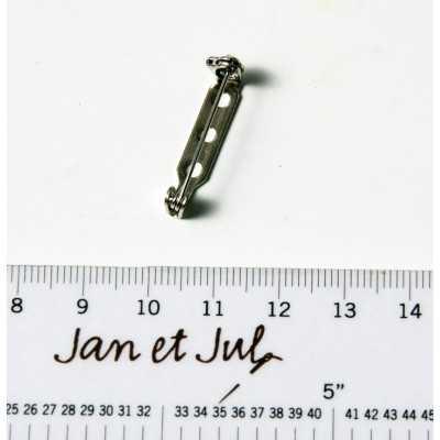 Broche con aguja de metal