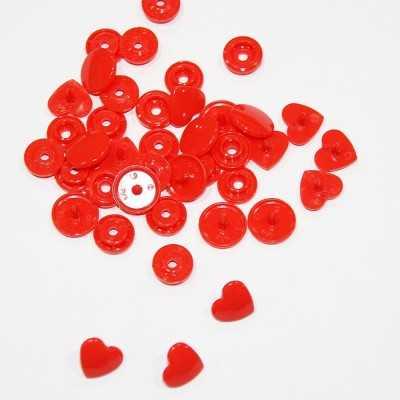 Snaps en forma de corazon rojos