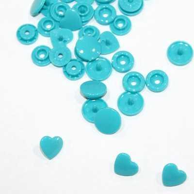 Snaps en forma de corazon turquesa