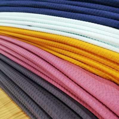 tela waffle o tejido de toalla de colores