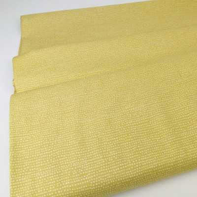 tela de patchwork mostaza con topos irregulares