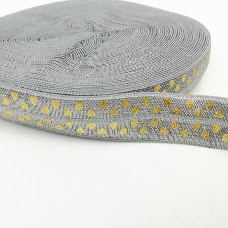 Goma gris y dorado