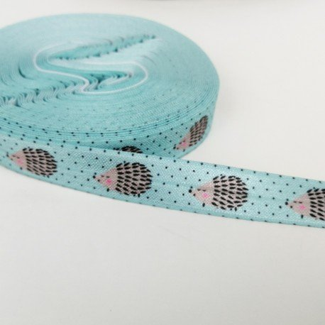 Goma elástica azul con dibujos de erizo