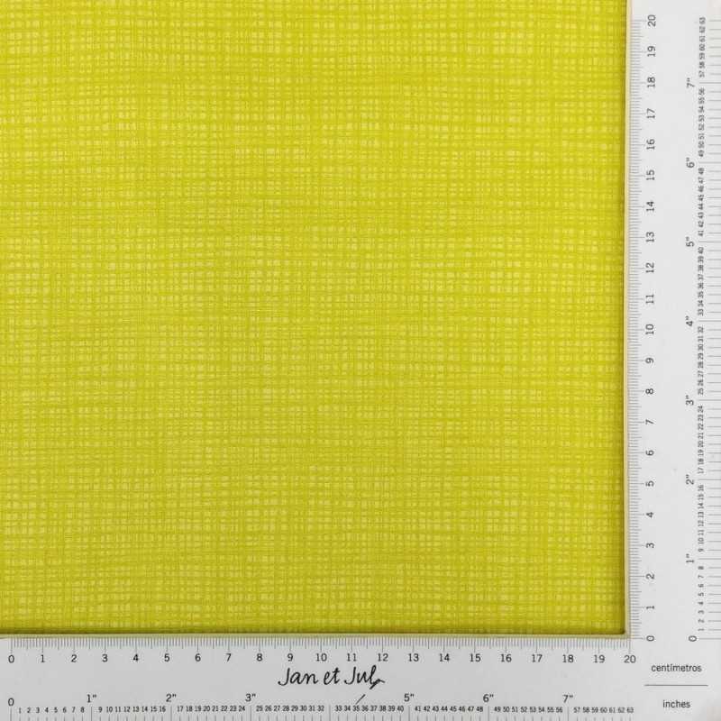 Tela de algodón amarillo verdoso