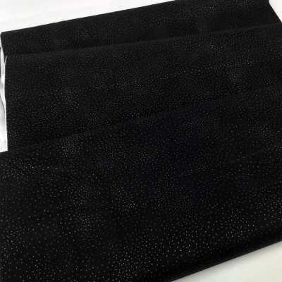 Tela negra de algodón con puntos dorados