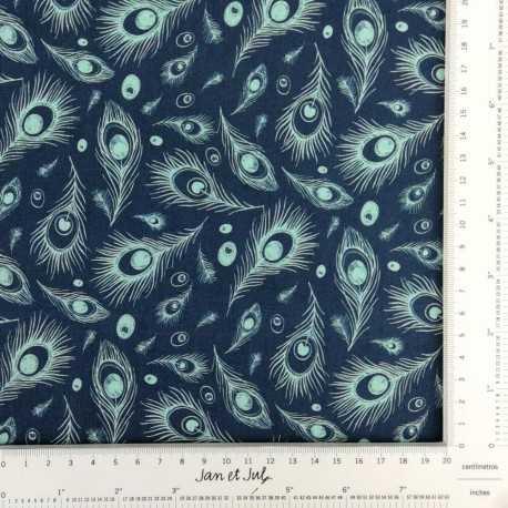 Tela de algodón en tonos turquesa y azul marino, con plumas