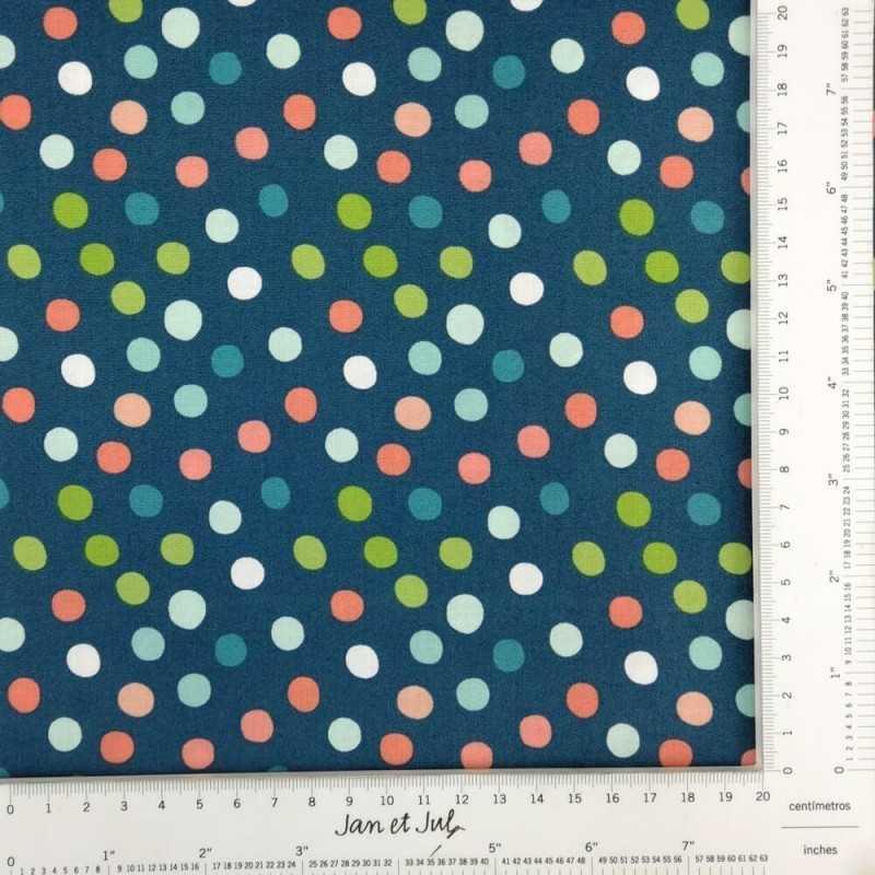 Tela de algodón con lunares de colores