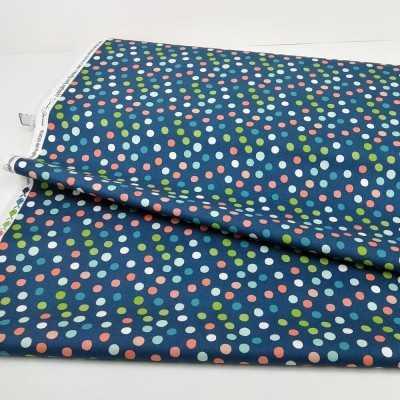 Tela de algodón con lunares de colores en azul, verde y coral