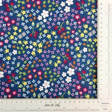 Tela de algodón azul con flores multicolor