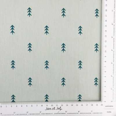Tela de fondo verde menta con pequeños abetos
