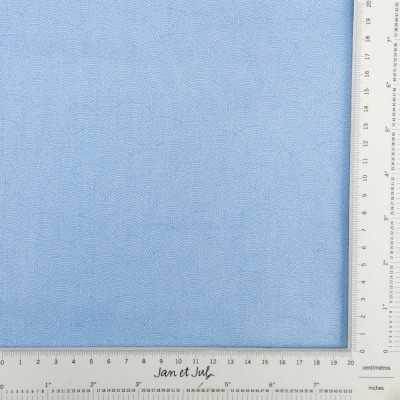 Tela de algodón azul con ondas