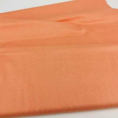 Tela de algodón en color naranja con dibujos estilo japonés