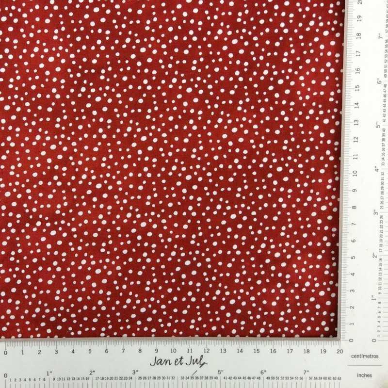 Tela de algodón rojo caldera con lunares irregulares en blanco