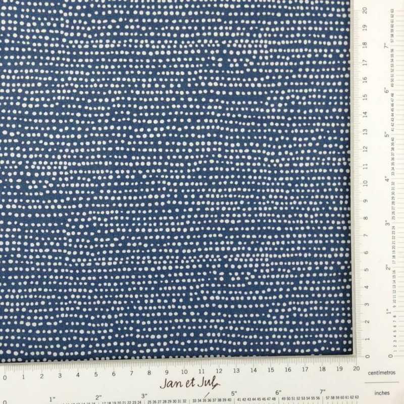 Tela azul oscuro con topos irregulares
