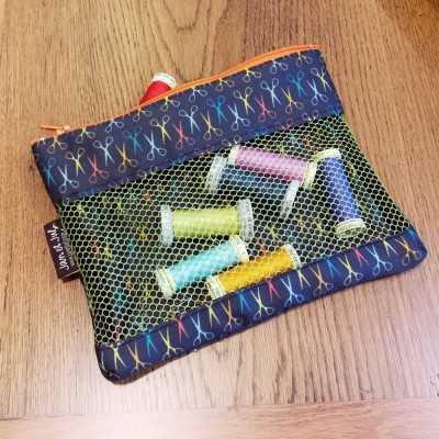 Bolsa mesh con tela de tijeras de Jan et Jul
