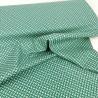 Tela de algodón verde con dibujos pequeños