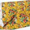 Tela de algodón americano con flores en tonos amarillos