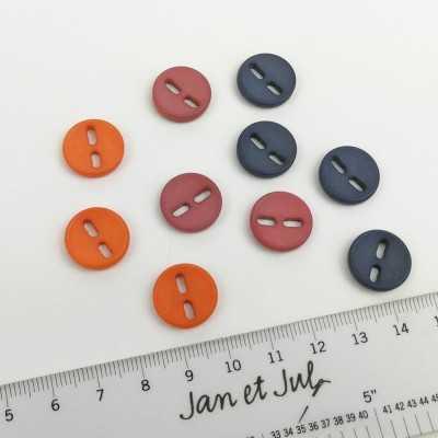 Botones variados de 15 mm con agujero alargado