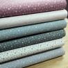 Telas de algodón con estrellas en tonos pastel