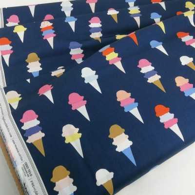 Tela de algodón azul oscuro con helados de colores