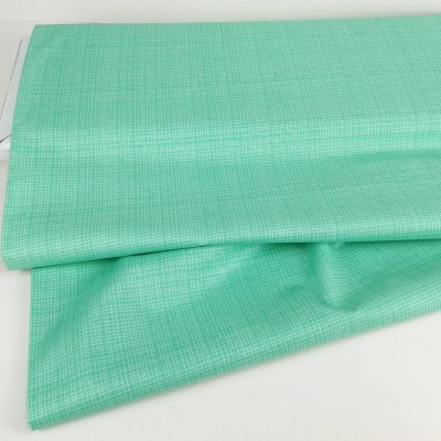 Tela de algodón de color verde turquesa