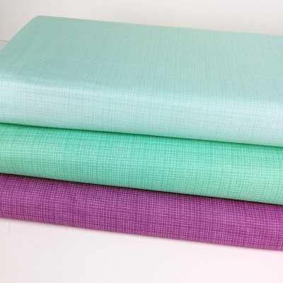 Combinación de telas de algodón americano de colores suaves verde turquesa, mint y morado