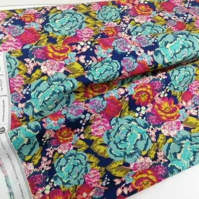 Tela de algodón con flores de colores grandes en azules, mostazas y fucsias