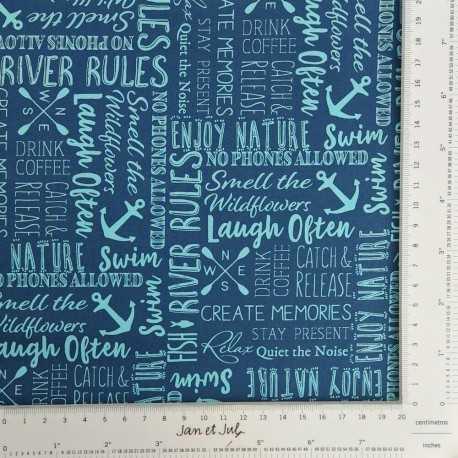 Tela de algodón americano azul con letras con motivos marineros