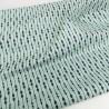 Tela de algodón turquesa con remos colocados de manera geométrica