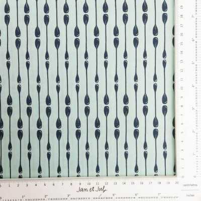 Tela de algodón americano color turquesa con remos colocados de manera geométrica