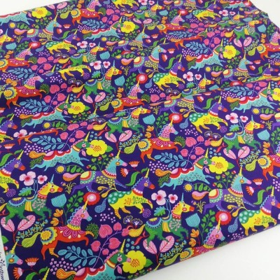 Tela de algodón americano colorida con unicornios